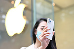 Apple fan shows Apple's 5G new iPhone 12 series at an Apple Store in Tokyo, Japan on October 23, 2020. (Photo by Naoki Nishimura/AFLO)