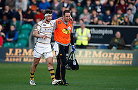 Photo: Richard Lane/Richard Lane Photography. Northampton Saints v London Wasps. Aviva Premiership. 24/03/2012. Wasps' Dominic Waldouck leaves the field injured with support from physio, Paul Tanner.