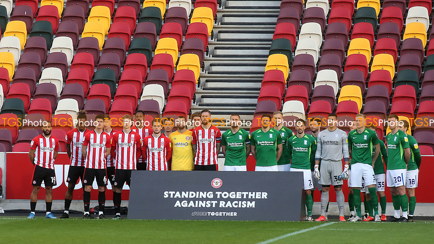 Brentford and Birmingham players stand together against racism prior to kick-off during Brentford vs Birmingham City, Sky Bet EFL Championship Football at the Brentford Community Stadium on 6th April 2021