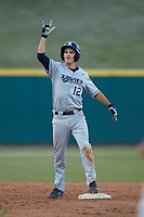 Mitch Gallagher (12) of the Xavier Musketeers celebrates a double against the Penn State Nittany Lions at Coleman Field at the USA Baseball National Training Center on February 25, 2017 in Cary, North Carolina. The Musketeers defeated the Nittany Lions 7-5 in game two of a double header. (Brian Westerholt/Four Seam Images)