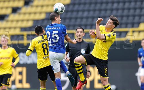 16th May 2020, Signal Iduna Park, Dortmund, Germany; Bundesliga football, Borussia Dortmund versus FC Schalke;  BVB's Leonardo Balerdi challenges S04 Amine Harit as BVB's Mahmoud Dahoud supports