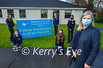 Presentation Tralee 1st years returning to school on Monday receive a big warm welcome. Front right: Bernie O'Connor (Teacher). Kneeling l to r: Sarah Carty and Faith O'Sullivan. Back l to r: Maria Synowiecka, Vanessa Popko and Joy Bamigbade.