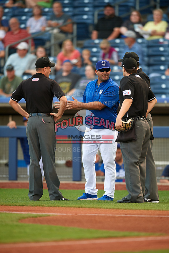 Tulsa Drillers Ryan Garko (31) talks with home plate umpire Jon Felczak, first base umpire Kyle Wallace and third base umpire Nate Tomlinson during a game against the Corpus Christi Hooks on June 3, 2017 at ONEOK Field in Tulsa, Oklahoma.  Corpus Christi defeated Tulsa 5-3.  (Mike Janes/Four Seam Images)