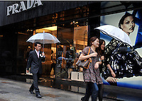 Shoppers pass Prada in the up-market  Ginza area of Central Tokyo, 17th September, 2008.<br />