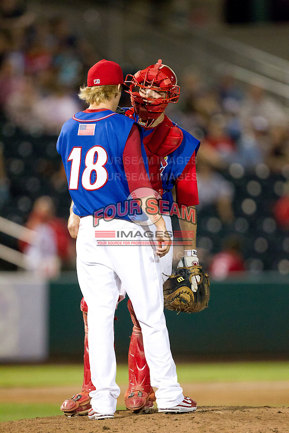 Jordan Swagerty (18) of the Springfield Cardinals talks with catcher Charles Cutler (37) during a game against the Corpus Christi Hooks at Hammons Field on August 13, 2011 in Springfield, Missouri. Springfield defeated Corpus Christi 8-7. (David Welker / Four Seam Images)