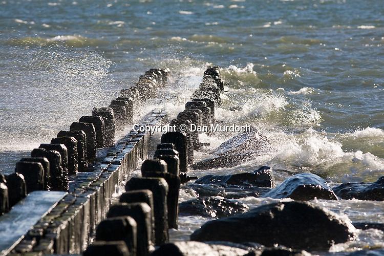 Waves crashing into breakwater