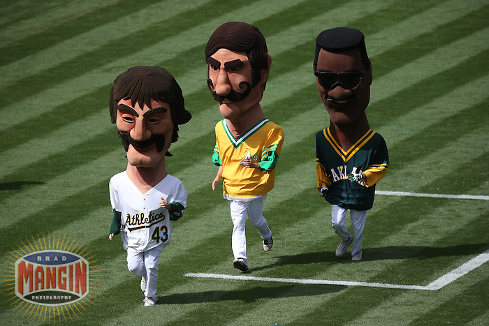 OAKLAND, CA - SEPTEMBER 2:  Dennis Eckersley, Rollie Fingers, and Rickey Henderson of the Oakland Athletics run in the Hall of Fame Race during the game against the Texas Rangers at O.co Coliseum on Monday, September 2, 2013 in Oakland, California. Photo by Brad Mangin