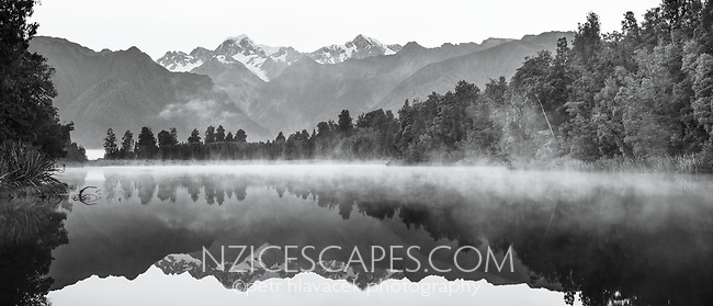 Lake Matheson and Southern Alps, with Mt. Tasman and Mt. Cook on horizon, Westland Tai Poutini National Park, West Coast, South Westland, UNESCO World Heritage Area, New Zealand, NZ