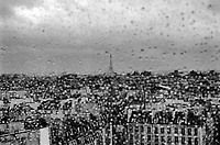 France. Ile-de-france Department. Paris. View from the Centre Georges Pompidou on the roofs of Paris and the Eiffel Tower. Rain drops on window glass. Rainy day. Centre Georges Pompidou, also known as the Pompidou Centre, is a complex in the Beaubourg area. 3.11.09 © 2009 Didier Ruef