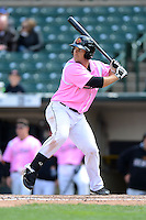 Rochester Red Wings first baseman Jeff Clement #20 during a game against the Columbus Clippers on May 12, 2013 at Frontier Field in Rochester, New York.  Rochester defeated Columbus 5-4 wearing special pink jerseys for Mother's Day.  (Mike Janes/Four Seam Images)