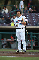 Matt Thaiss (12) of the Inland Empire 66ers bats against the San Jose Giants at San Manuel Stadium on April 8, 2017 in San Bernardino, California. (Larry Goren/Four Seam Images)