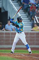 Idaho Falls Chukars Juan Carlos Negret (12) at bat during a Pioneer League game against the Missoula Osprey at Melaleuca Field on August 20, 2019 in Idaho Falls, Idaho. Idaho Falls defeated Missoula 6-3. (Zachary Lucy/Four Seam Images)