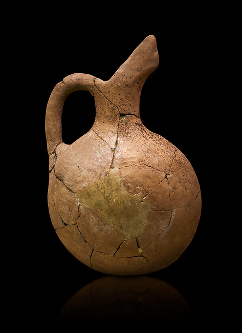 Assyrian Traders terra cotta imported beak spout pictcher. 1900 - 1600 BC. Çorum Archaeological Museum, Corum, Turkey. Against a black bacground.