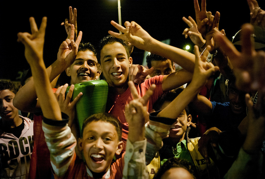 Libyan youth wave victory signs after Mustafa Abdul-Jalil declares the liberation of Libya in Benghazi, Libya, Friday, October 23, 2011. Three days after the death of Muammar Gaddafi Libya's NTC leaders addressed a jubilant crowd at a ceremony in Benghazi to mark an official end to the revolution, and the start of a new beginning for the country.