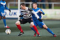 Shire's Neil McCabe tries to get away from Montrose's Terry Masson.