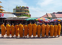 Buddhist Monks collecting their Alms in the rural town of Battambang, Cambodia