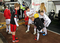 SWANSEA, WALES - MARCH 16: Young Swansea supporters are shown how to freestyle by Ash Randall<br /> Re: Premier League match between Swansea City and Liverpool at the Liberty Stadium on March 16, 2015 in Swansea, Wales