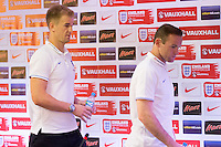 Goalkeeper Joe Hart and Wayne Rooney of England leave the press conference