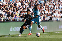 ST PAUL, MN - AUGUST 14: Efraín Alvarez #26 of the Los Angeles Galaxy and Bakaye Dibassy #12 of Minnesota United FC battle for the ball during a game between Los Angeles Galaxy and Minnesota United FC at Allianz Field on August 14, 2021 in St Paul, Minnesota.