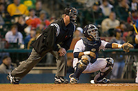 Catcher Diego Seastrunk #5 of the Rice Owls sets up in front of home plate umpire Danny Moscarro during game action versus the Baylor Bears in the 2009 Houston College Classic at Minute Maid Park March 1, 2009 in Houston, TX.  The Owls defeated the Bears 8-3. (Photo by Brian Westerholt / Four Seam Images)