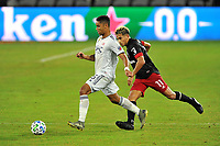 WASHINGTON, DC - SEPTEMBER 27: Brandon Bye #15 of New England Revolution battles for the ball with Yamil Asad #11 of D.C. United during a game between New England Revolution and D.C. United at Audi Field on September 27, 2020 in Washington, DC.