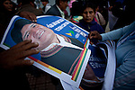 ©PATRICIO CROOKER<br /> La Paz, Bolivia<br /> A picture dated November 26, 2009 show a woman supporter of Bolivian President and presidential candidate Evo Morales distributes posters of Morales to supporters in a campaign event in the City of La Paz.  Morales are running for re-election for the MAS (Movement Towards Socialism) party, and has more than 50% support of the population.