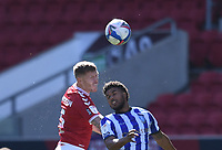 27th September 2020; Ashton Gate Stadium, Bristol, England; English Football League Championship Football, Bristol City versus Sheffield Wednesday; Alfie Mawson of Bristol City competes in the air with Joost van Aken of Sheffield Wednesday