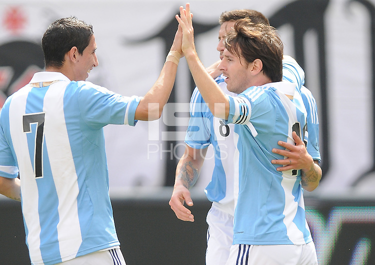 Argentina forward Lionel Messi (10) celebrates his score in the 31th minute of the game with teamates. The Argentina National Team defeated Brazil 4-3 at MetLife Stadium, Saturday July 9 , 2012.