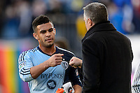 Dom Dwyer (14) of Sporting Kansas City fist bumps with manager Peter Vermes after being subbed out during the second half against the  of the Philadelphia Union. Sporting Kansas City defeated the Philadelphia Union 2-1 during a Major League Soccer (MLS) match at PPL Park in Chester, PA, on October 26, 2013.