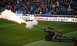 The start of a minutes silence is marked with firing of an artillery gun at Ibrox Stadium for Remembrance weekend