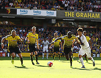 Ki Sung-yueng of Swansea takes on Allan-Romeo Nyom of Watford   during the Barclays Premier League match Watford and Swansea   played at Vicarage Road Stadium , Watford