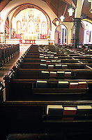 Interior of church showing rows of pews<br />