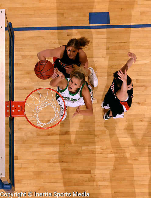 BROOKINGS, SD - March 12th, 2009 : Pierre's Katie Lingle nails her lay up around Huron defenders Paige Shonley and Brittany Hirschkorn during the 2009 State AA Girls Basketball Tournament in Frost Arena on the campus of South Dakota State University in Brookings, SD. (Photo By Ty Carlson/Inertia)