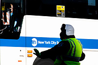 NEW YORK, NY - NOVEMBER 18:  A MTA's bus drives through Times Square on November 18, 2020 in New York. MTA is facing a $3 billion deficits that will bring reductions of Subways, trains and buses of 40-50% in service, and layoffs of over 9,000 staff. (Photo by Eduardo MunozAlvarez/VIEWpress)