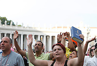 Appartenenti del Rinnovamento nello Spirito Santo pregano durante l'incontro con Papa Francesco in Piazza San Pietro, Citta' del Vaticano, 3 luglio 2015.<br /> Members of the Catholic Charismatic Renewal movement pray during their meeting with Pope Francis in St. Peter's Square at the Vatican, 3 July 2015.<br /> UPDATE IMAGES PRESS/Isabella Bonotto<br /> <br /> STRICTLY ONLY FOR EDITORIAL USE