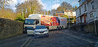 Pictured: The Tesco lorry remains stuck for the first time at Terrace Road and Rose Hill in Swansea, Wales, UK.  Tuesday 11 February 2020<br /> Re: A Tesco articulated lorry remained stranded in a narrow residential street for hours in the early hours of the morning, only to get stuck again moments after the its driver managed to get moving again. The lorry attempted to negotiate turning from Terrace Road into Rose Hill in the Mount Pleasant area of Swansea after apparently its driver was following his sat nav. The driver of a white car-which was parked legally- was traced and moved his car just after 9am. A few hundred metres the lorry got stuck again trying to negotiate a tight right hand turn, due to cars parked -legally- on either side of the road.