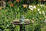 Bird bath in flower garden