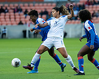 HOUSTON, TX - JANUARY 31: Melchie Dumonay #6 of Haiti and Raquel Rodriguez #11 of Costa Rica vie for the ball during a game between Haiti and Costa Rica at BBVA Stadium on January 31, 2020 in Houston, Texas.