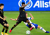 LOS ANGELES, CA - SEPTEMBER 02: Tommy Thompson #22 of the San Jose Earthquakes battles Jose Cifuentes #11 of LAFC for a loose ball during a game between San Jose Earthquakes and Los Angeles FC at Banc of California stadium on September 02, 2020 in Los Angeles, California.