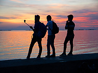 Selfies at sunset along Manila Bay, Philippines
