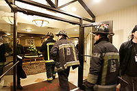 Boston (MA) USA - Jan 2006 file Photo - Firemen respond to a false alarm in an hotel