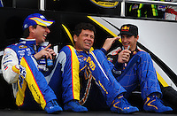 Feb 22, 2009; Fontana, CA, USA; NASCAR Sprint Cup Series drivers David Reutimann (left), Michael Waltrip (center) and Scott Speed prior to the Auto Club 500 at Auto Club Speedway. Mandatory Credit: Mark J. Rebilas-