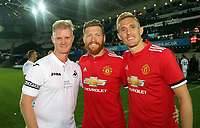 Alan Tate of Swansea Legends with Manchester United players during the Swansea Legends v Manchester United Legends at The Liberty Stadium, Swansea, Wales, UK. Wednesday 09 August 2017