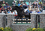 Niklas Jonsson and First Lady of Sweden compete in the final stadium jumping round of the FEI  World Eventing Championship at the Alltech World Equestrian Games in Lexington, Kentucky.