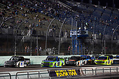 #51: Christian Eckes, Kyle Busch Motorsports, Toyota Tundra Mobil 1, #99: Ben Rhodes, ThorSport Racing, Ford F-150 Dish Fish/Go Fish, and #4: Todd Gilliland, Kyle Busch Motorsports, Toyota Tundra JBL/SiriusXM
