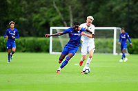 Dynel Simeu of Chelsea FC battles with Arnor Gudjohnsen of Swansea City during the Premier League u18 match between Swansea City AFC and Chelsea FC at Landore Training Ground, Wales, UK. Tuesday 11th September 2018
