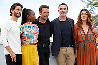 """CANNES, FRANCE - JULY 17: Pierre Niney, Fatou N'Diaye, Nicolas Bedos, Jean Dujardin and Natacha Lindinger at photocall for the film """"OSS 117 : Alerte Rouge en Afrique Noire"""" (OSS 117 : From Africa With Love) at the 74th annual Cannes Film Festival in Cannes, France on July 17, 2021 <br /> CAP/GOL<br /> ©GOL/Capital Pictures"""