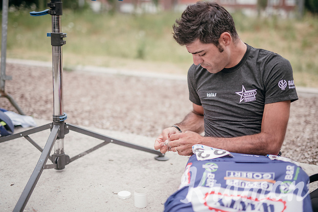 Danilo Napolitano (ITA/Wanty - Groupe Gobert) pinning on his race numbers by the roadside (as there was no teambus/-van) available for this race<br /> <br /> 10th Heistse Pijl 2017