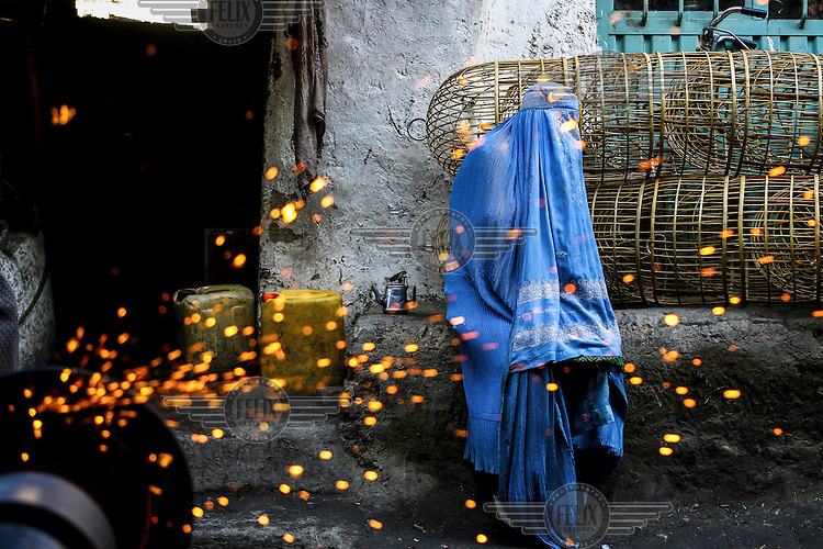 """An Afghan woman sits in the Bazaar at the <br /> """"Old Kabul"""" /Felix Features"""