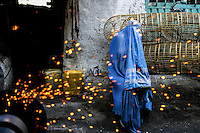 "An Afghan woman sits in the Bazaar at the <br /> ""Old Kabul"" /Felix Features"